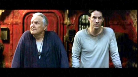 Anthony Zerbe and Keanu Reeves talk encrypted shop in The Matrix Reloaded.