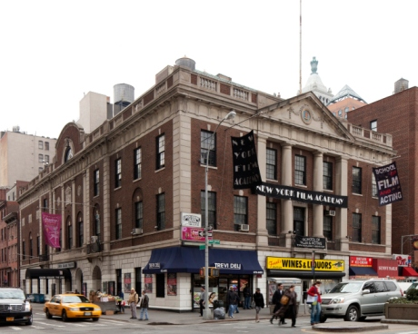 Tammany Hall today. Occupants include a deli, a liquor store, and a film academy.