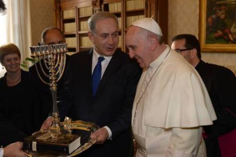 Israeli Prime Minister Benjamin Netanyahu presents fellow toiler for peace Pope Francis with a token of their shared Judeo-Christian values during a visit to the Vatican.